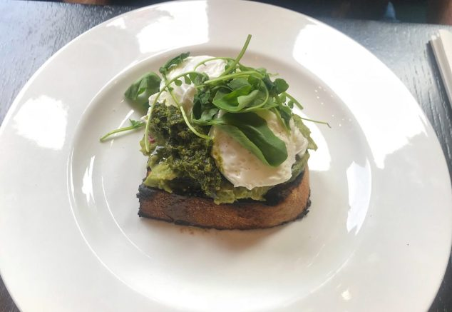 Sourdough toast with avocado, poached egg and salsa verde - Grand Cafe